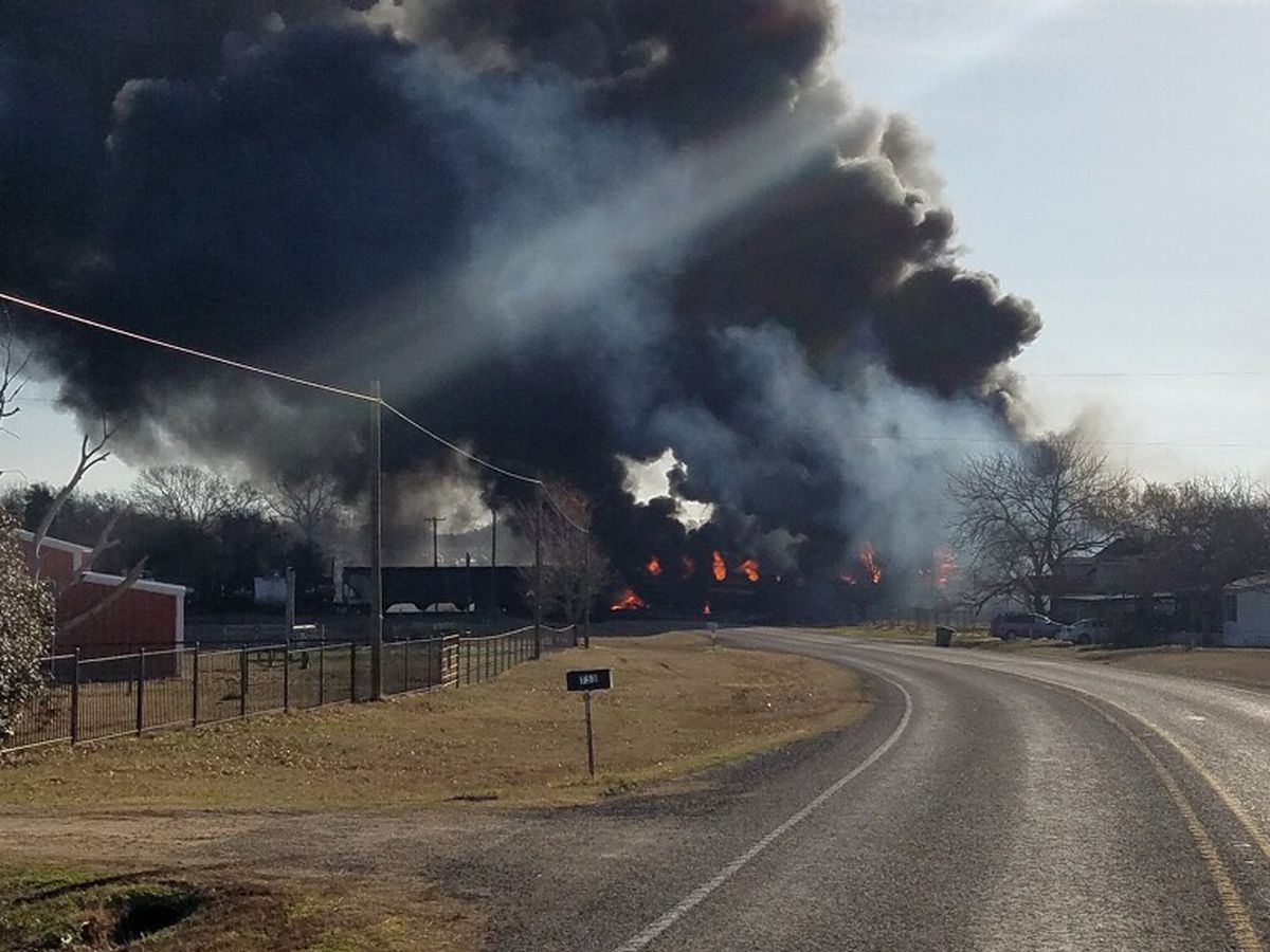 Tanker cars burst into flames after train hits 18-wheeler in Texas