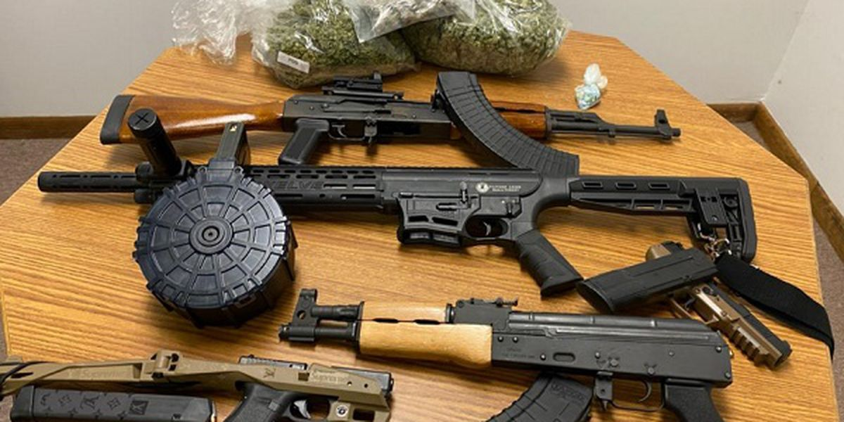Two arrested after drugs, weapons found in search