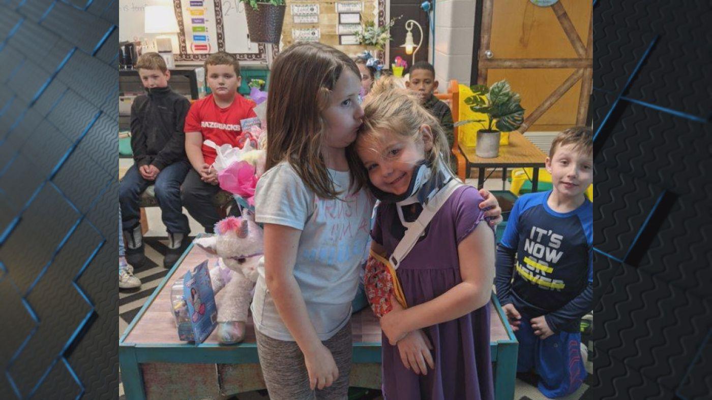 (Left to Right) Kylee Schisler, 9, saves sister Maddie Schisler, 6, from dog attack