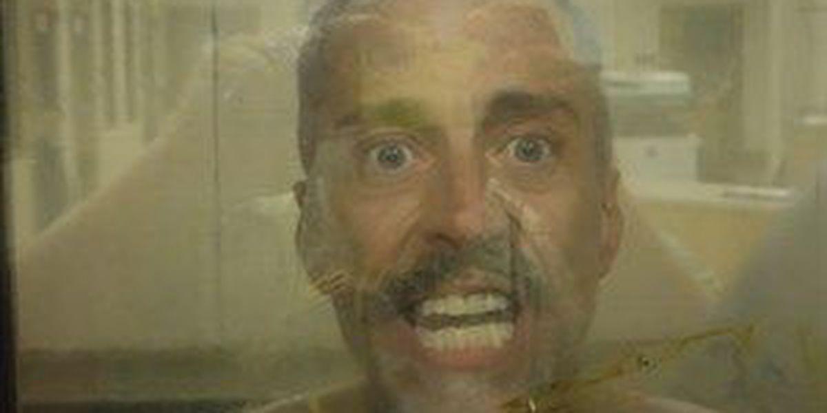 Police: Man was nude, threatening neighbors with garden shears