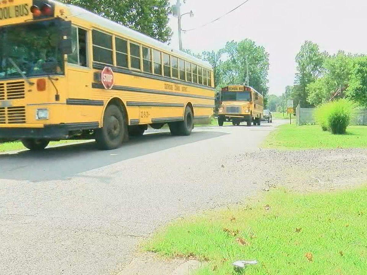 Narrow road has neighbors near school asking questions