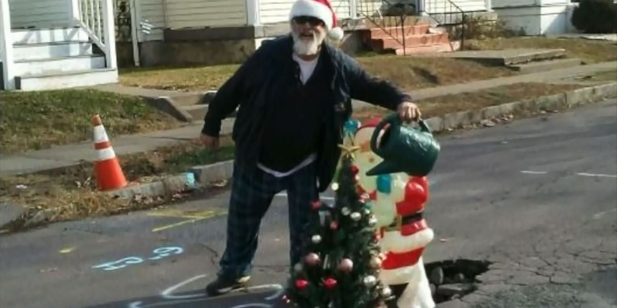 Neighbors put Christmas tree and Santa in street to call attention to pothole
