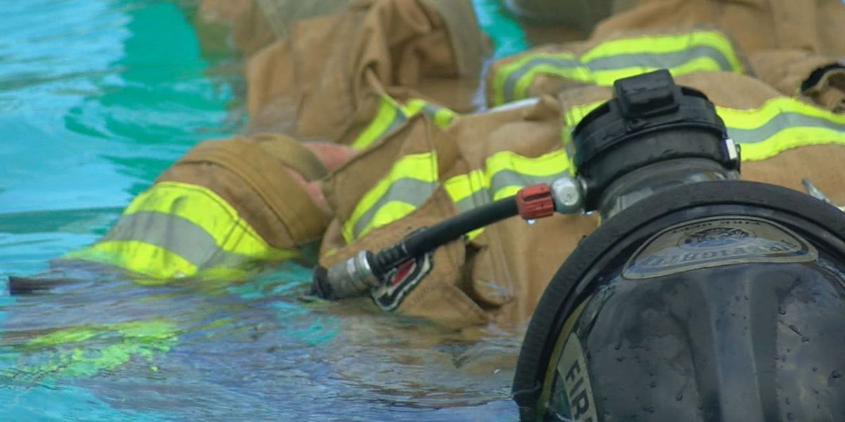 Firefighters train for wearing gear in water