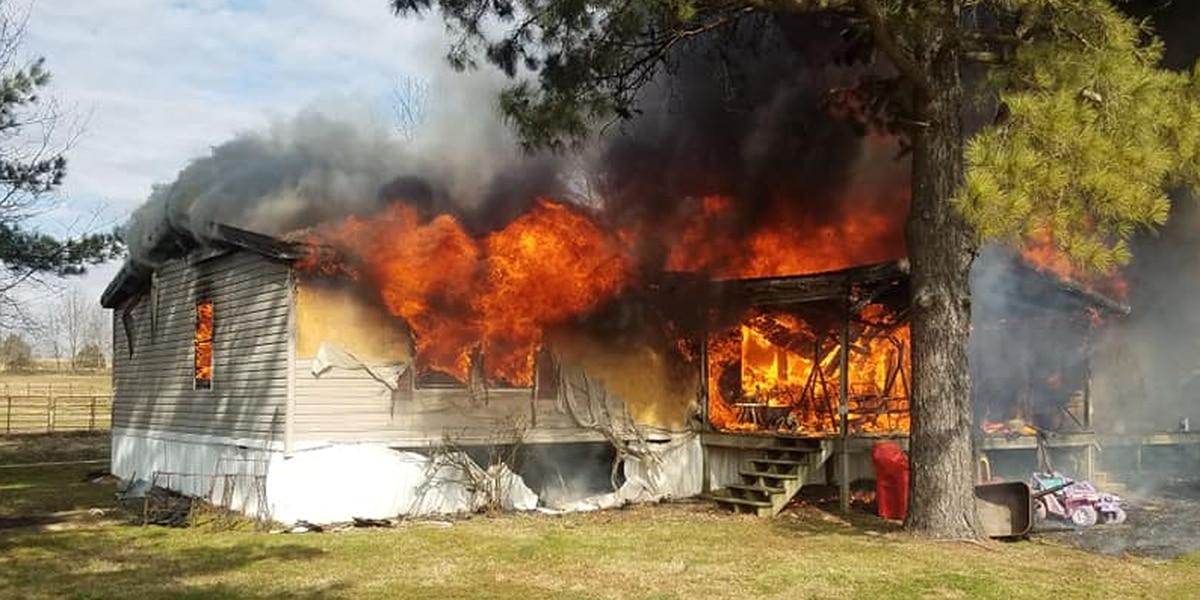 Firefighters battle blaze at trailer home