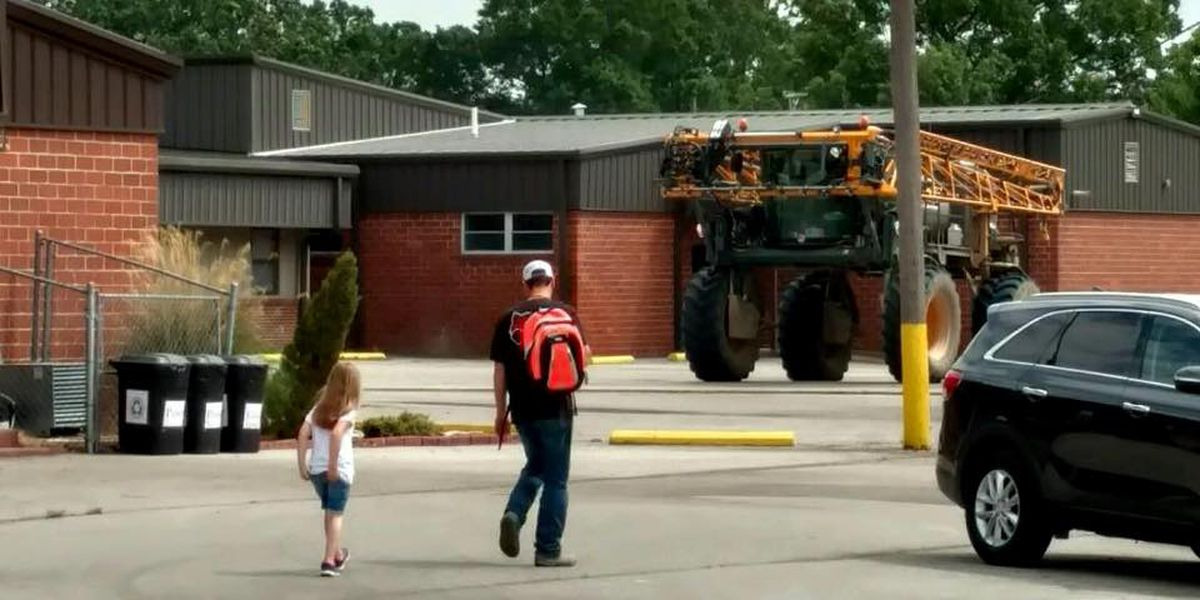 VIRAL PHOTO: Dad picks up daughter from school in spray rig