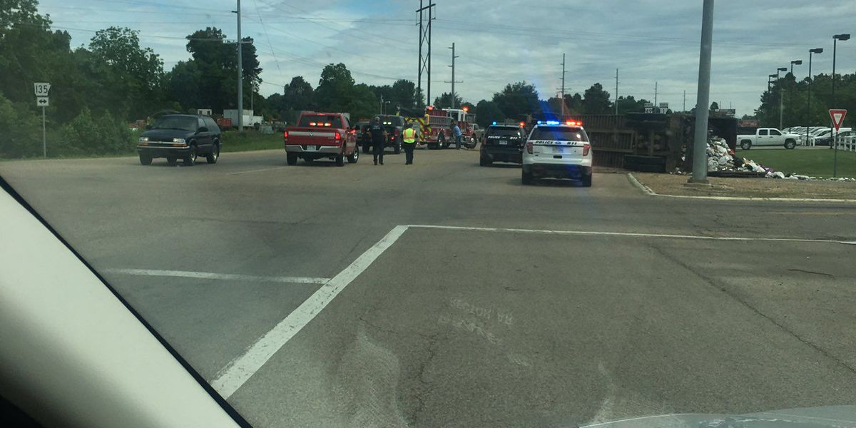 Trash truck overturns, slows traffic at intersection