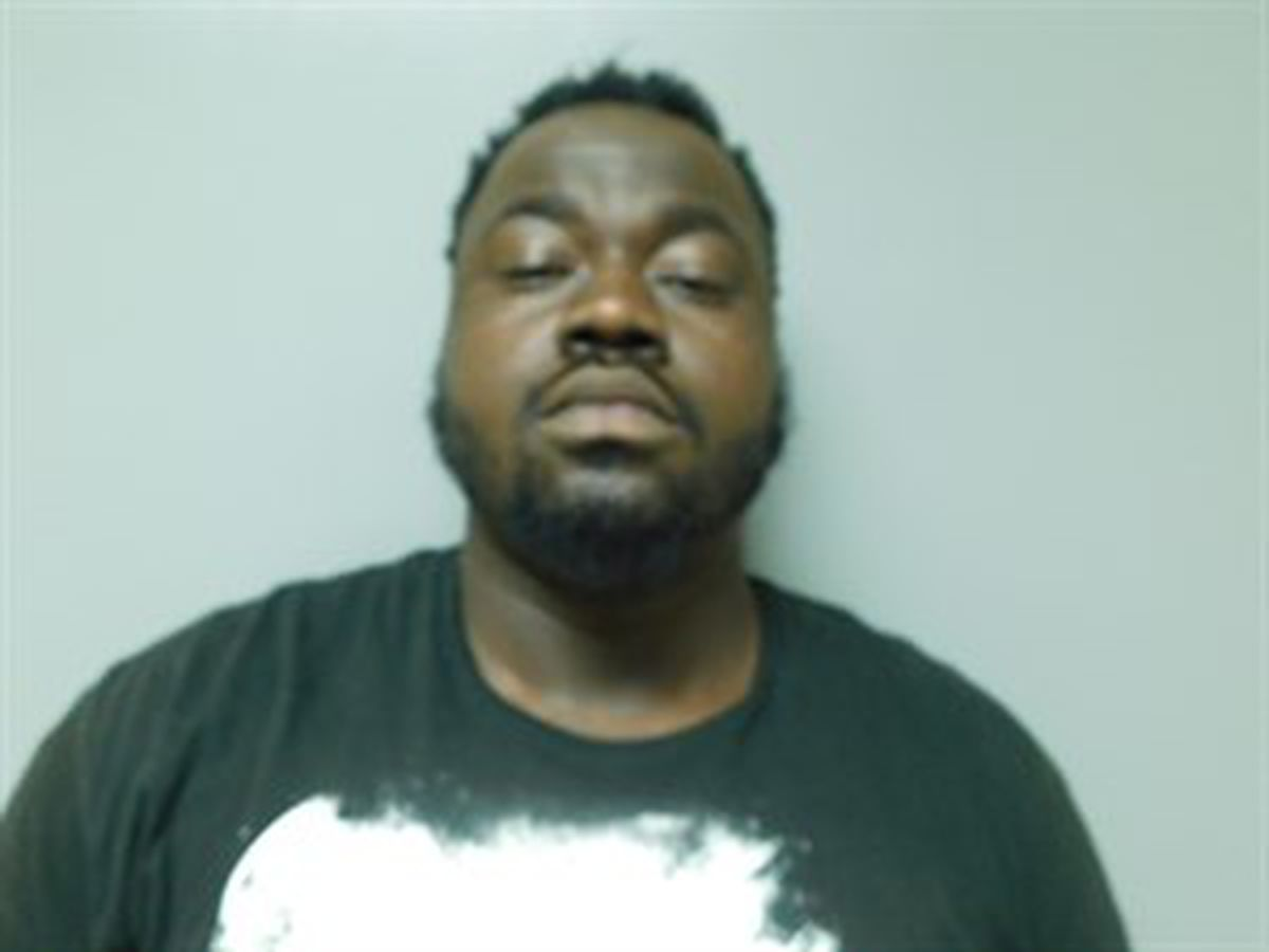 Man arrested after pointing gun at residents
