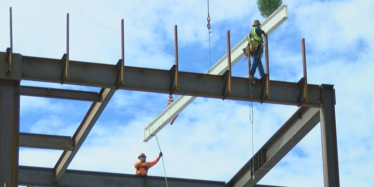 Local hospital celebrates topping out ceremony