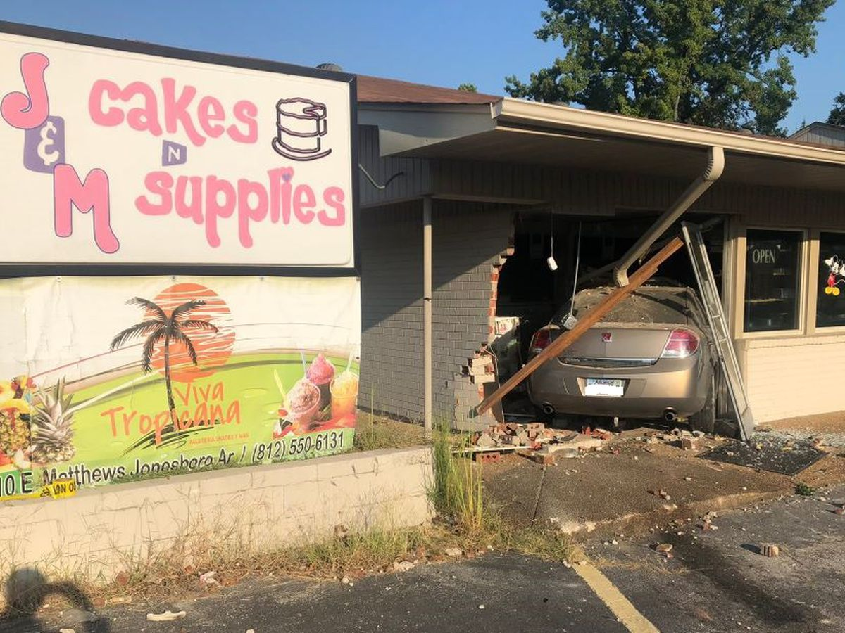 Car crashes into business, injuring motorist