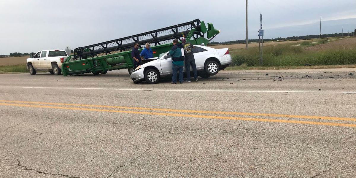 TRAFFIC ALERT: Car collides with combine header