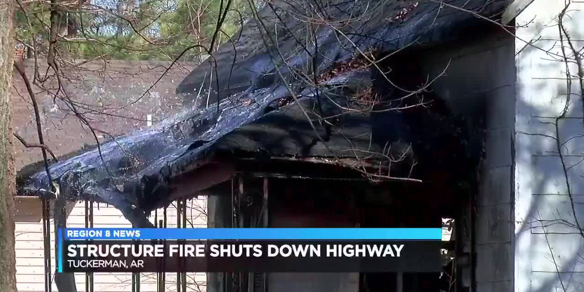 Structure fire shuts down highway