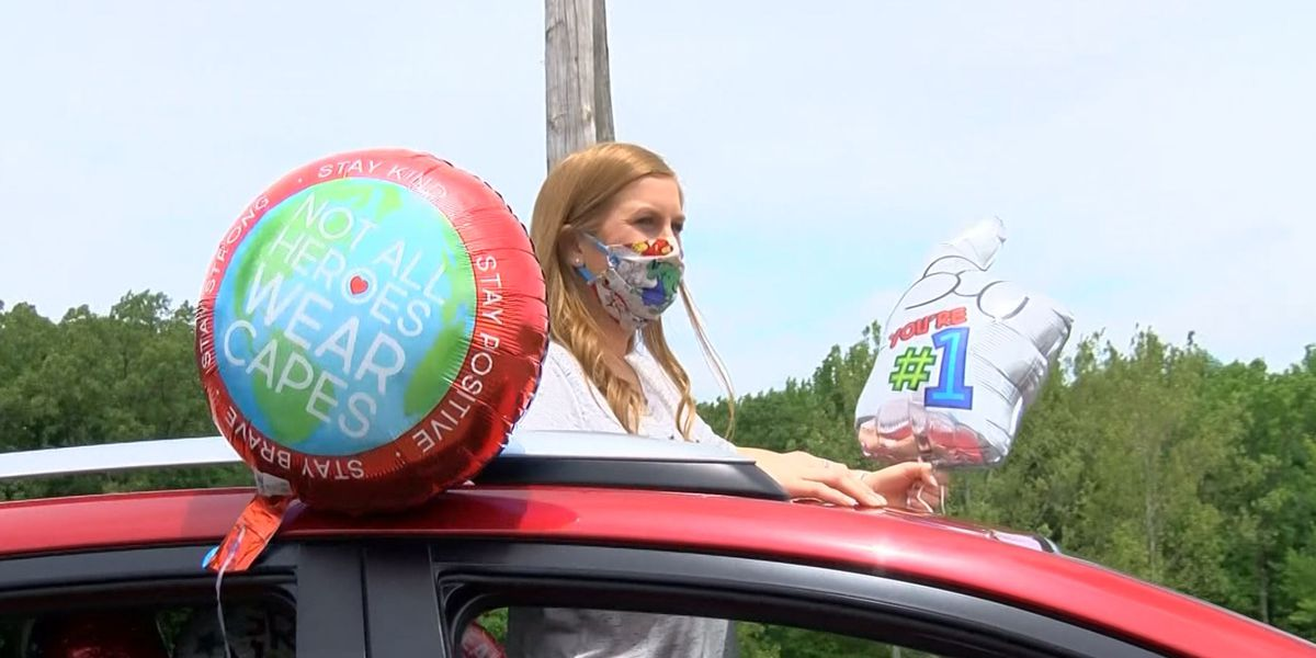 Neighborhood welcomes nurse home from NYC with social distancing party