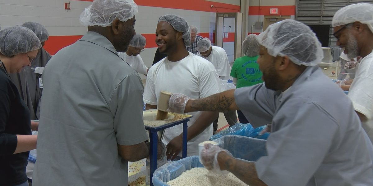 Heartland inmates pack meals for hungry kids in other countries