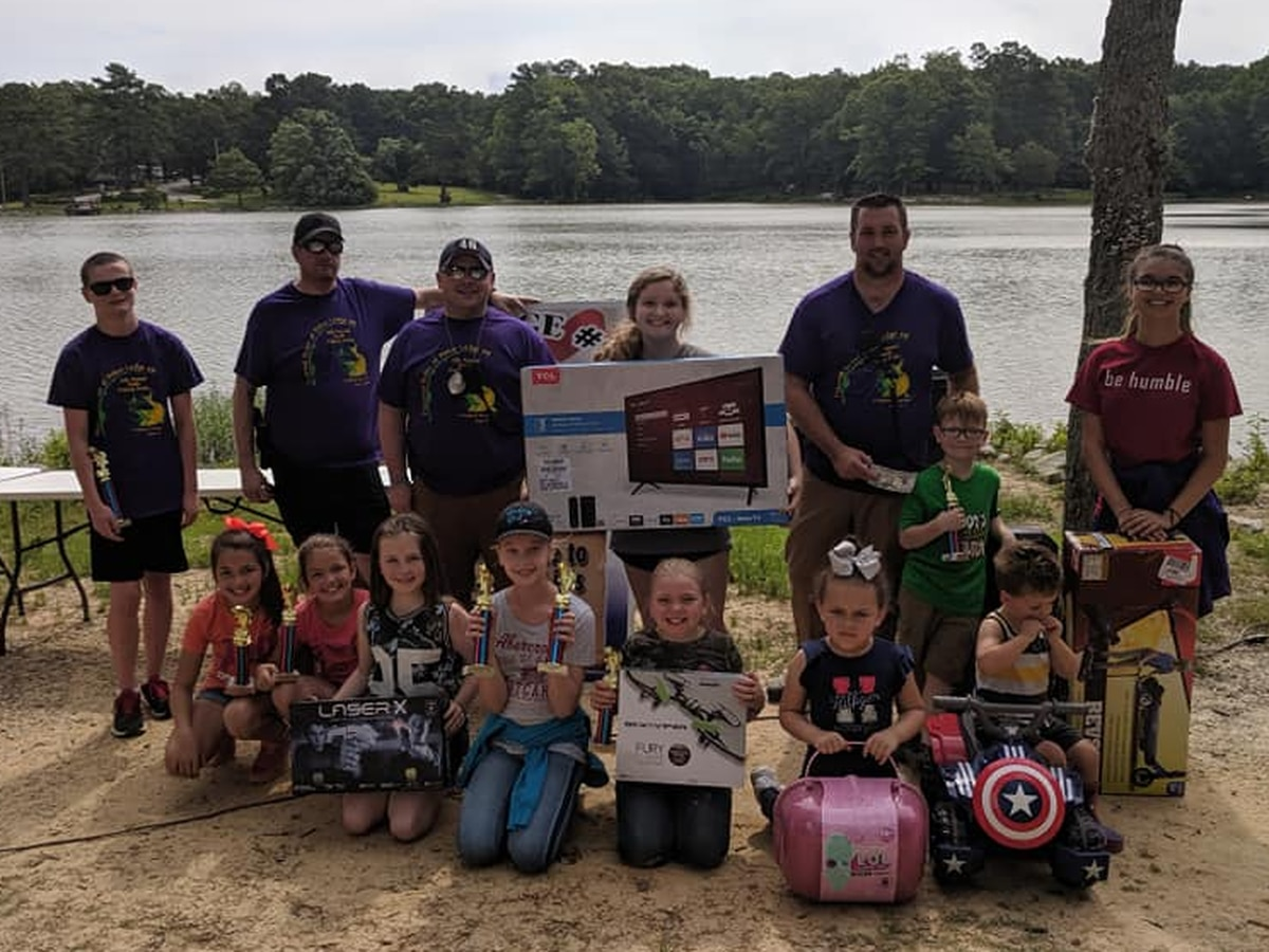 Fishing derby held for children, with trophies and prizes awarded