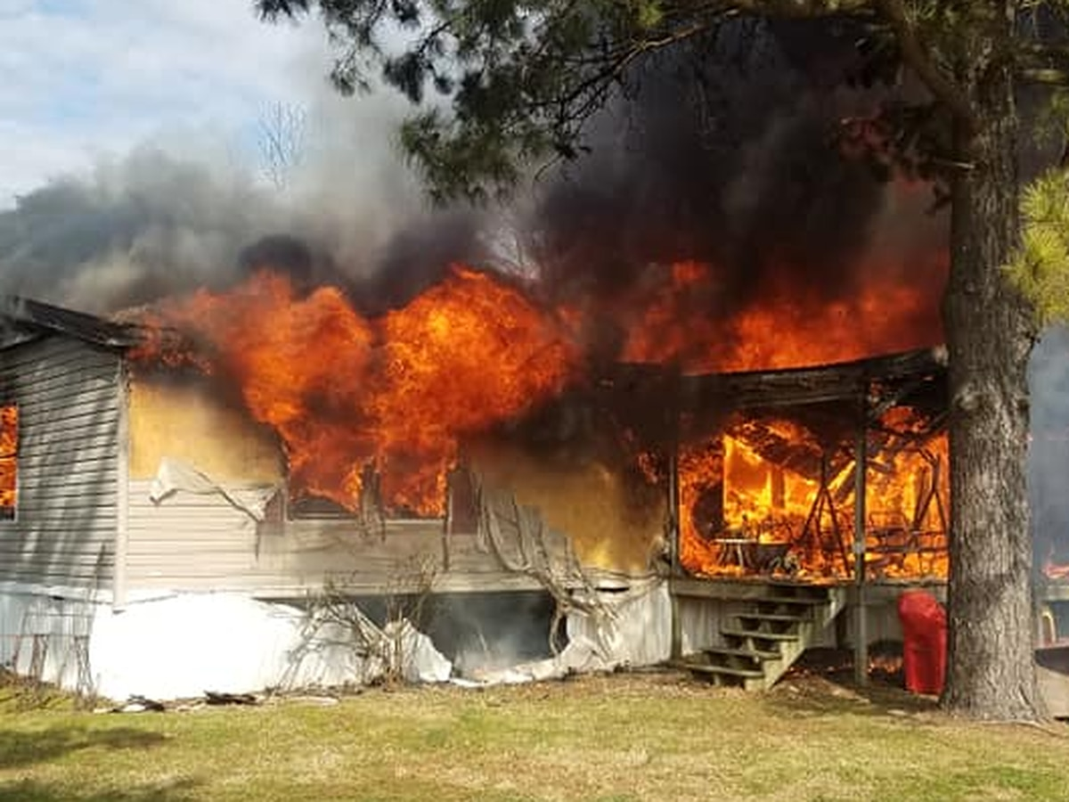 Firefighters battle blaze at trailer home