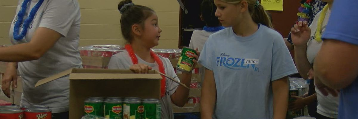 Volunteers work to feed the hungry
