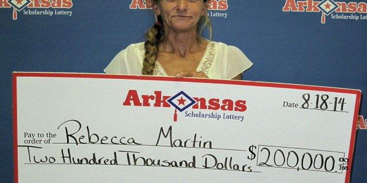 Local woman cashes in 200K lotto ticket