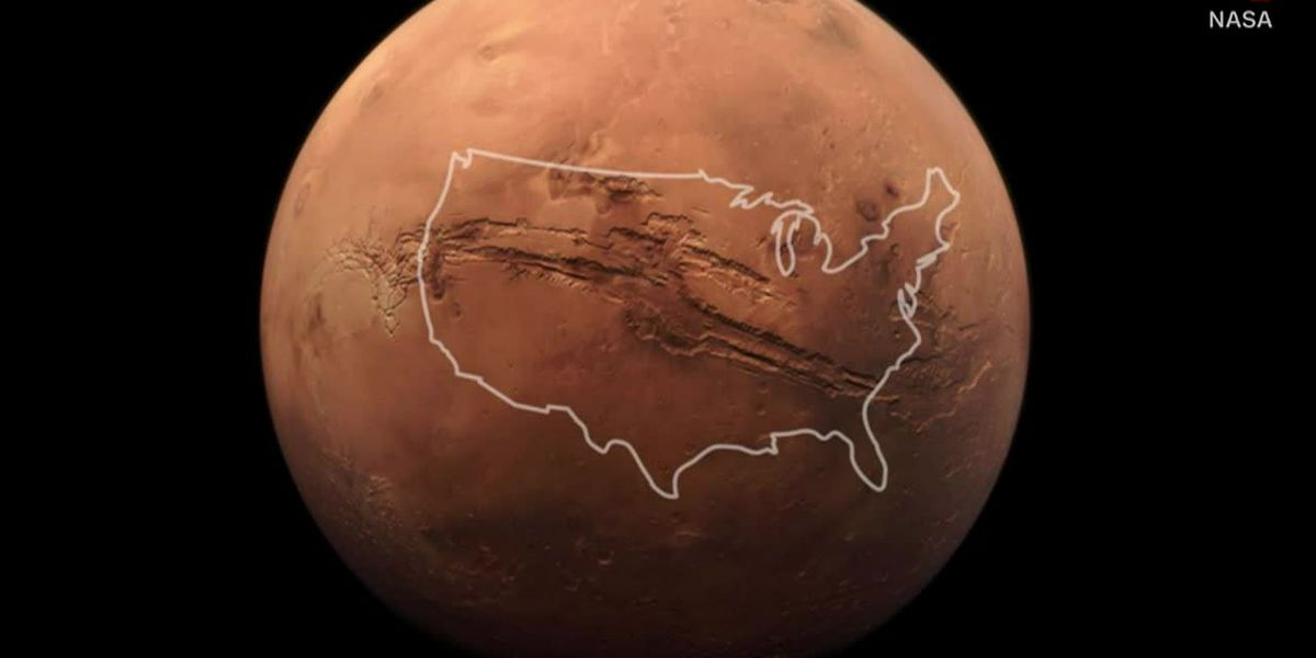 NASA shows off biggest canyon in solar system