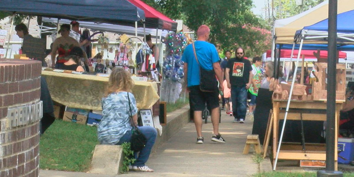Sidewalks line up with local vendors at arts and crafts fair