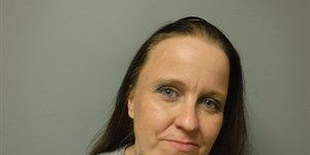 Woman faces real charges for fake money