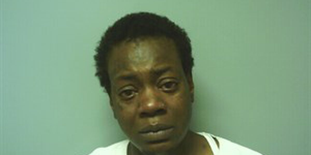 Woman arrested, charged after hitting man with liquor bottle, stabbing him