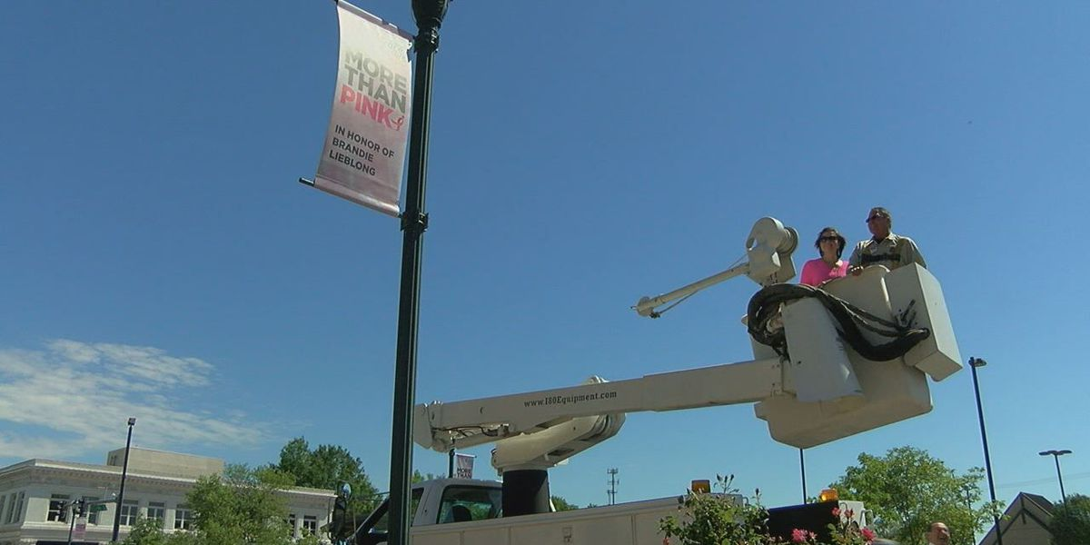 Mayor hangs flag to paint downtown pink, honors survivor