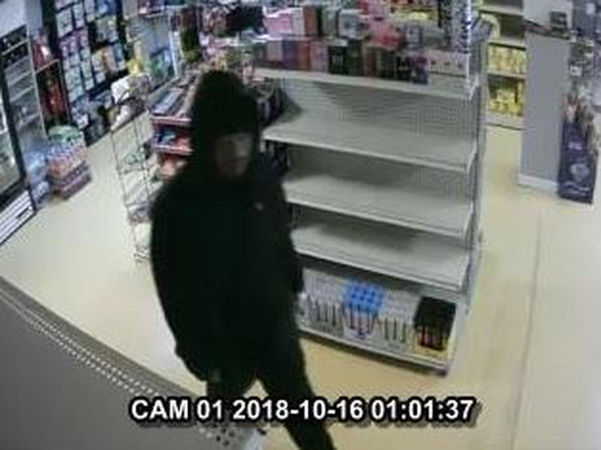 Tobacco store robbed, police searching for suspect