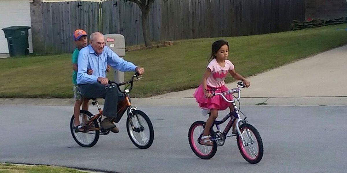 78-year-old man rides bike with neighborhood kids