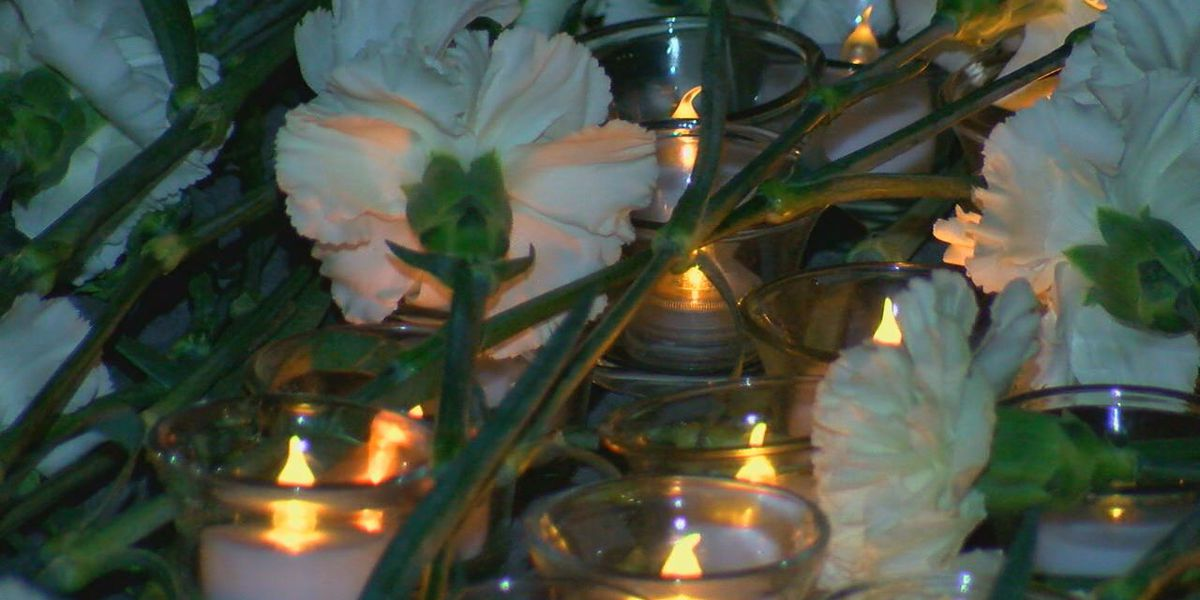 Candlelight vigil held in memory of children