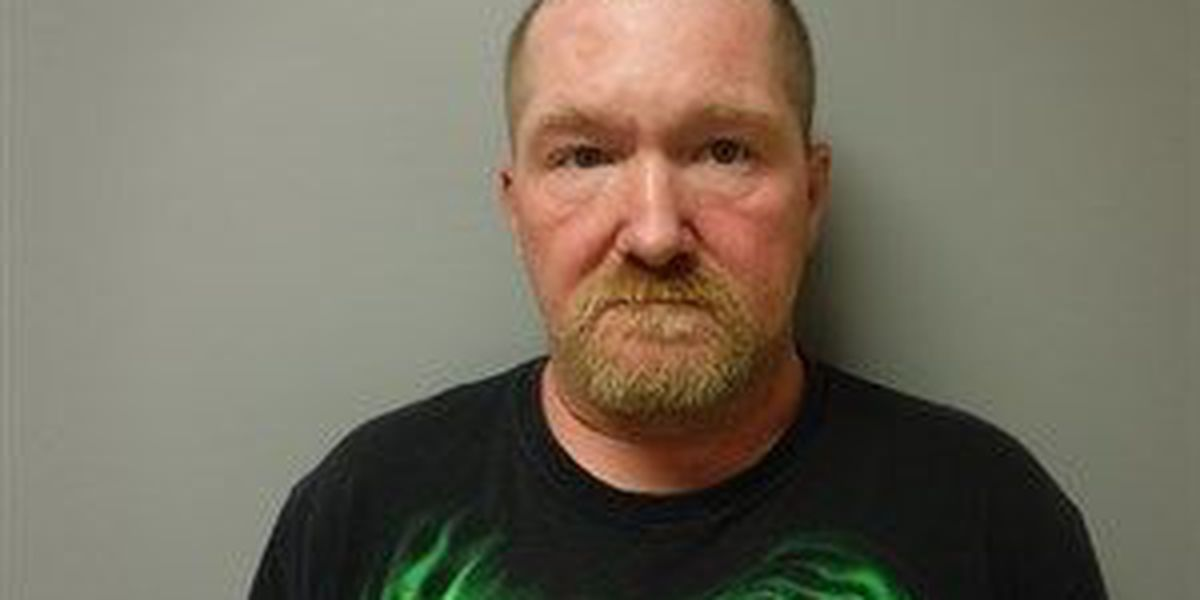 Suspect charged in 2014 burglary