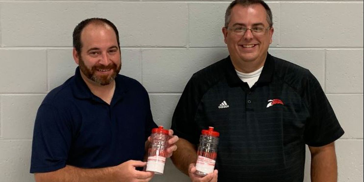 Church donates 500 water bottles to school district