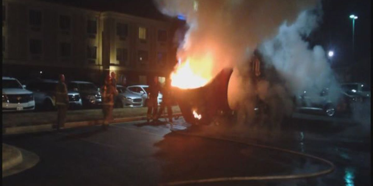 VIDEO: Fire crew extinguishes dump truck fire in parking lot
