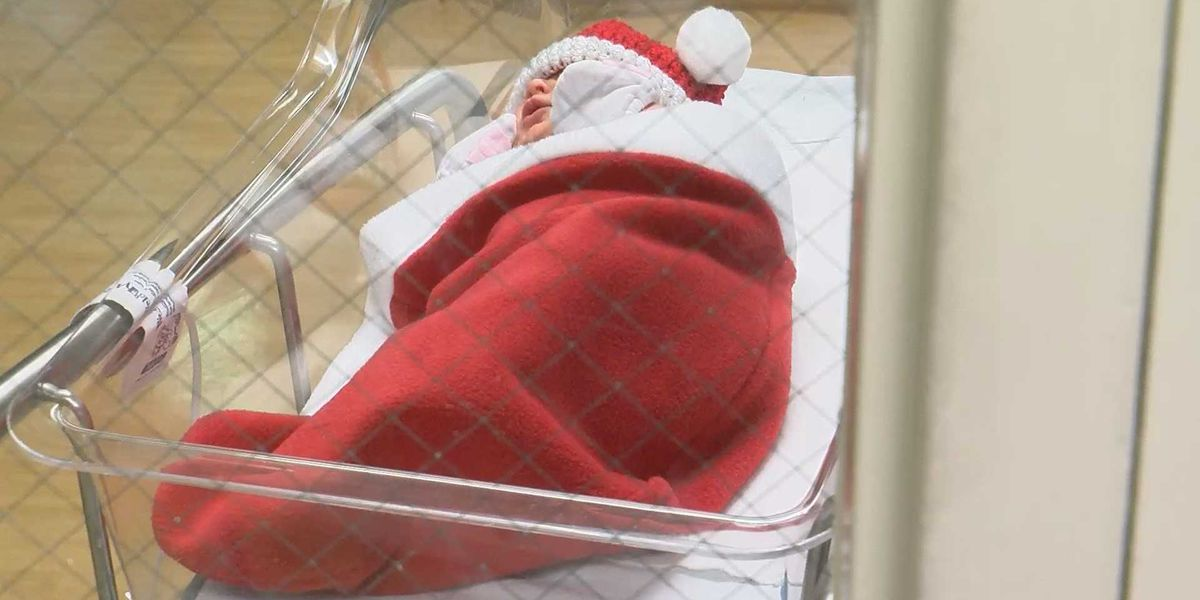 Newborns wrapped in stockings for Christmas