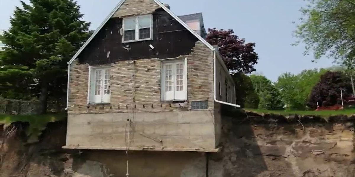 House teeters on the edge of cliff over Lake Michigan