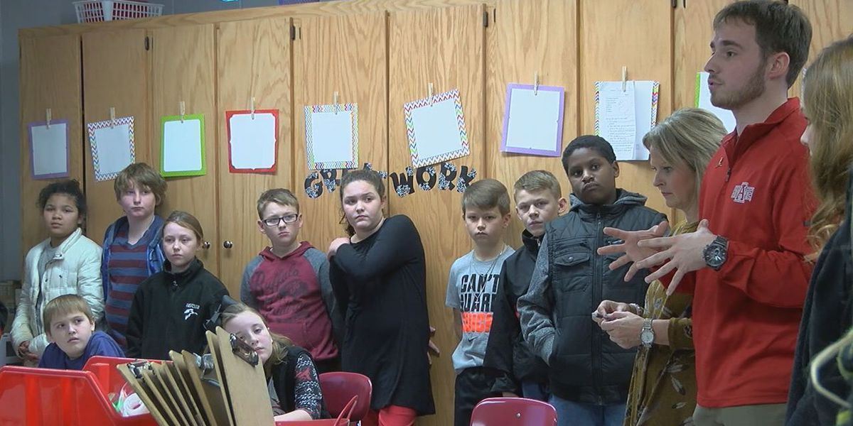A-State football players visit students to celebrate MLK Day