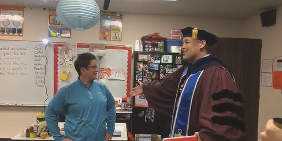 A-State Chancellor surprises graduate student who couldn't attend ceremony