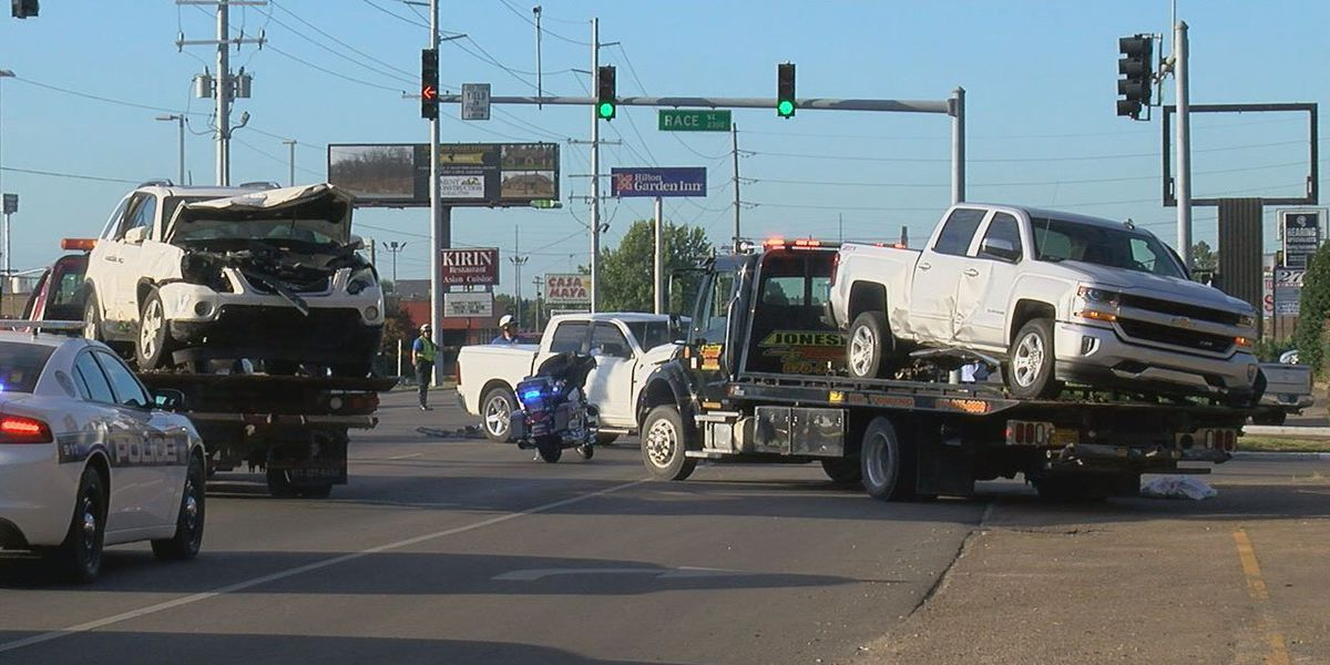 Signal light, power pole damaged in crash; 2 injured