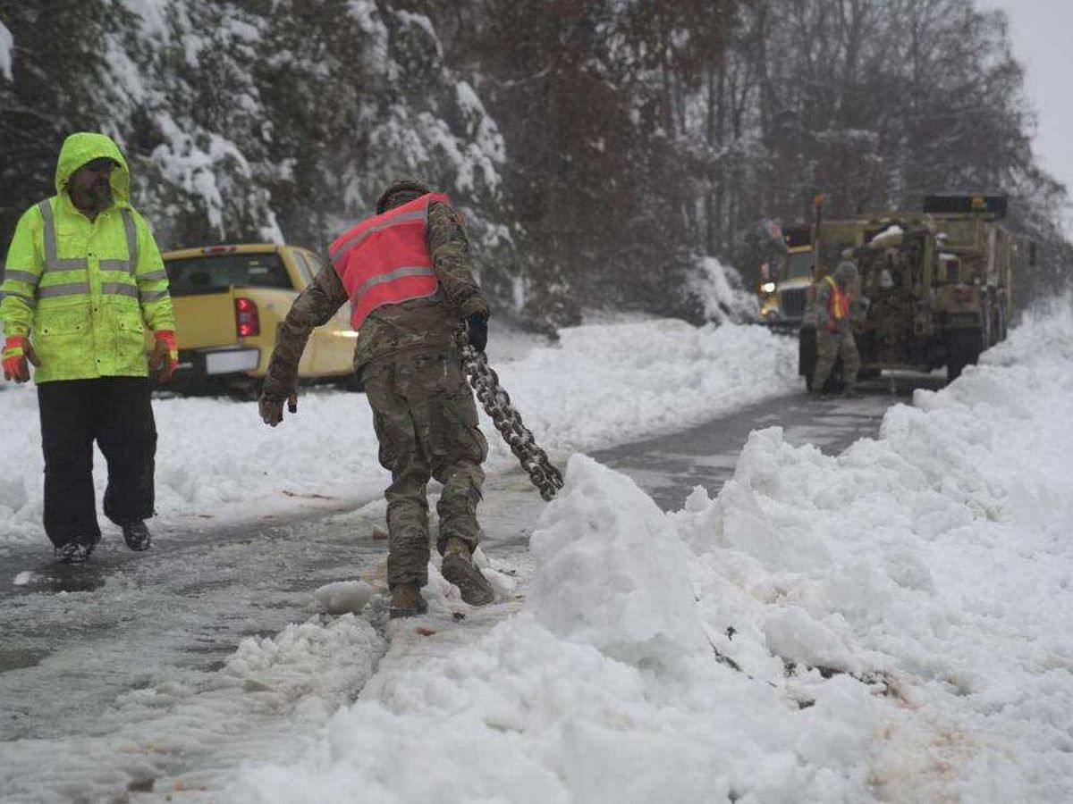 NC National Guard soldiers pull ambulance from snowbank, transport infant in 12″ of snow