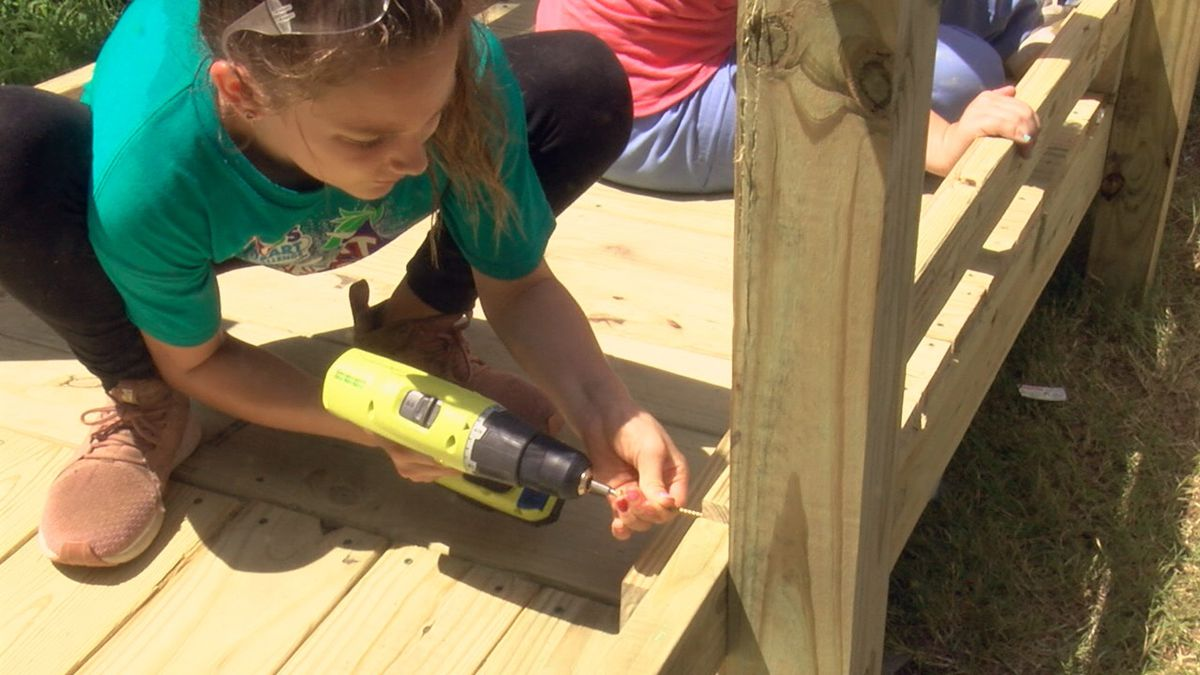 Campers build wheelchair ramp, other projects for people in need