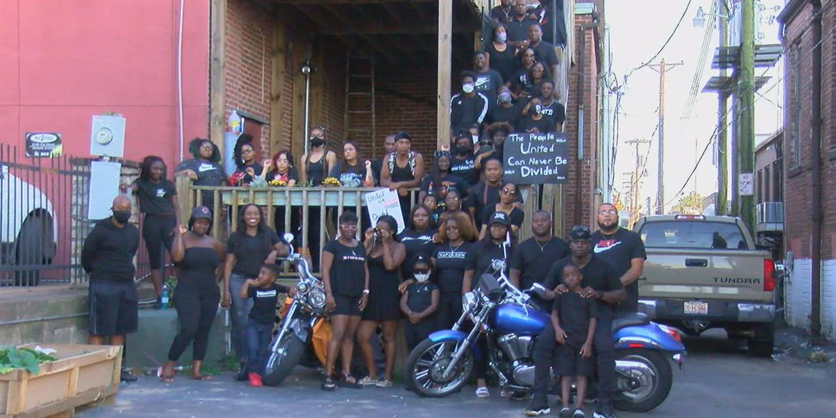 People gather to participate in blackout unity photo shoot