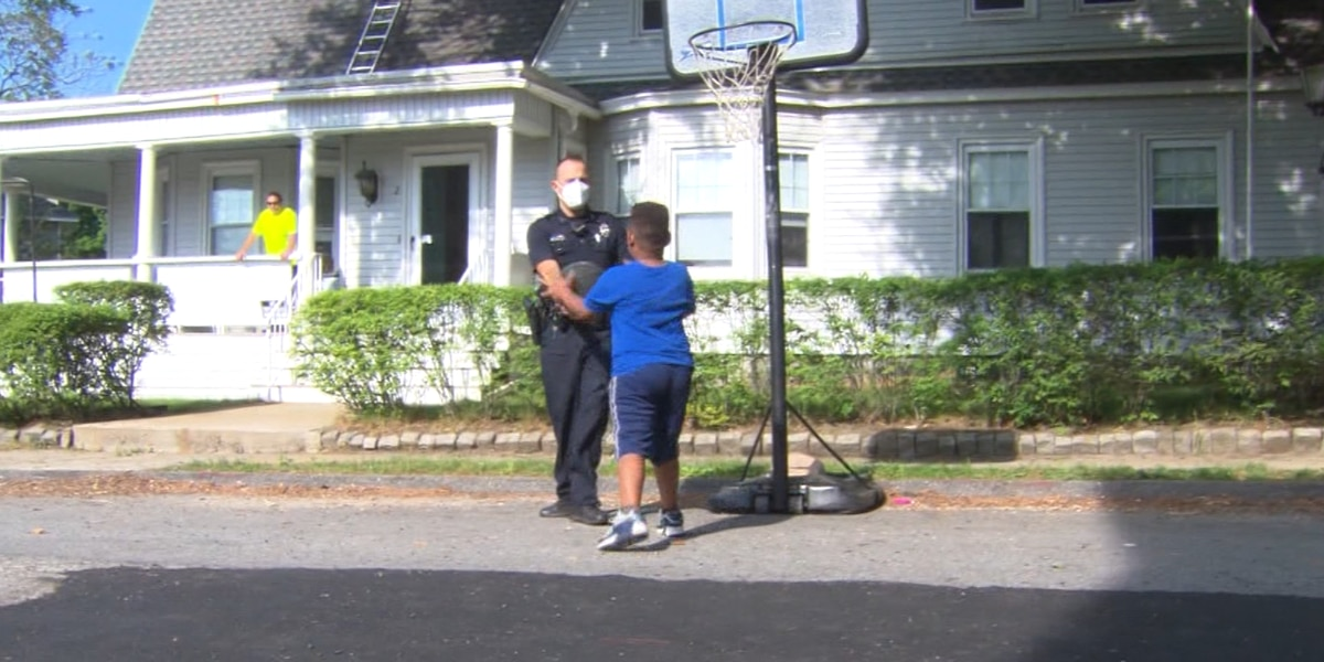A Massachusetts police officer plays an impromptu basketball game with a 6-year-old