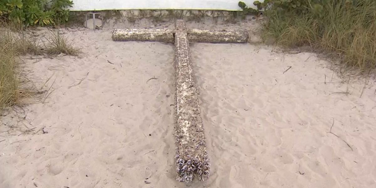 Holy water: Giant cross washes ashore on Florida beach