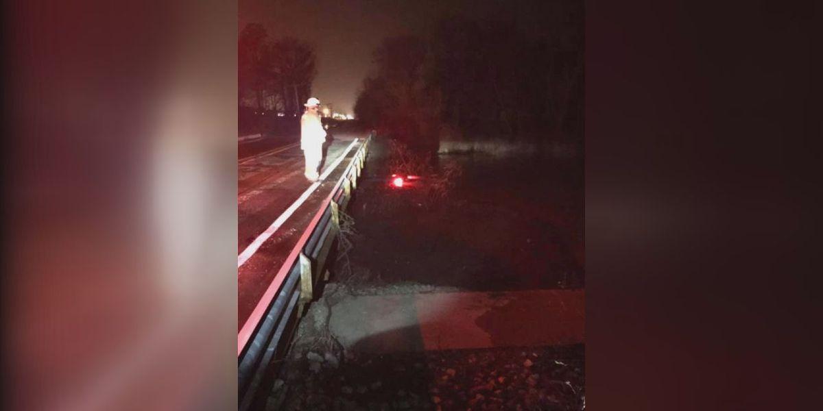 Car goes off bridge and into lake