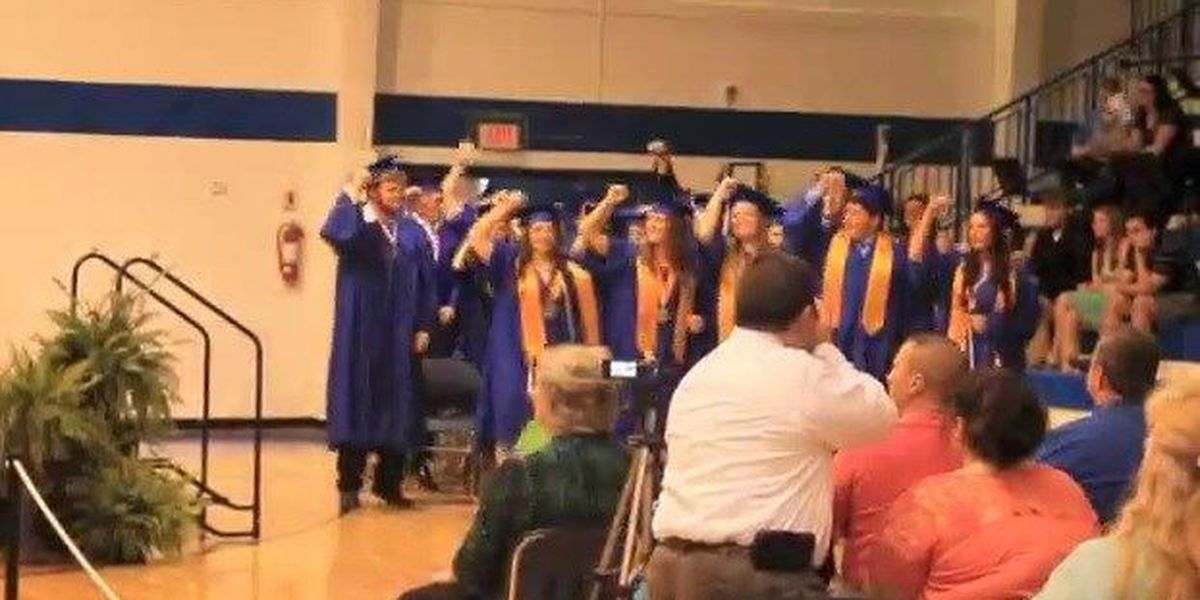 High school students jam out during graduation ceremony