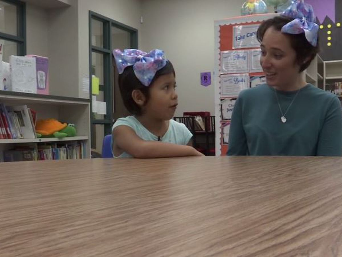 Teacher cuts waist-length hair to support 5-year-old girl bullied for short haircut
