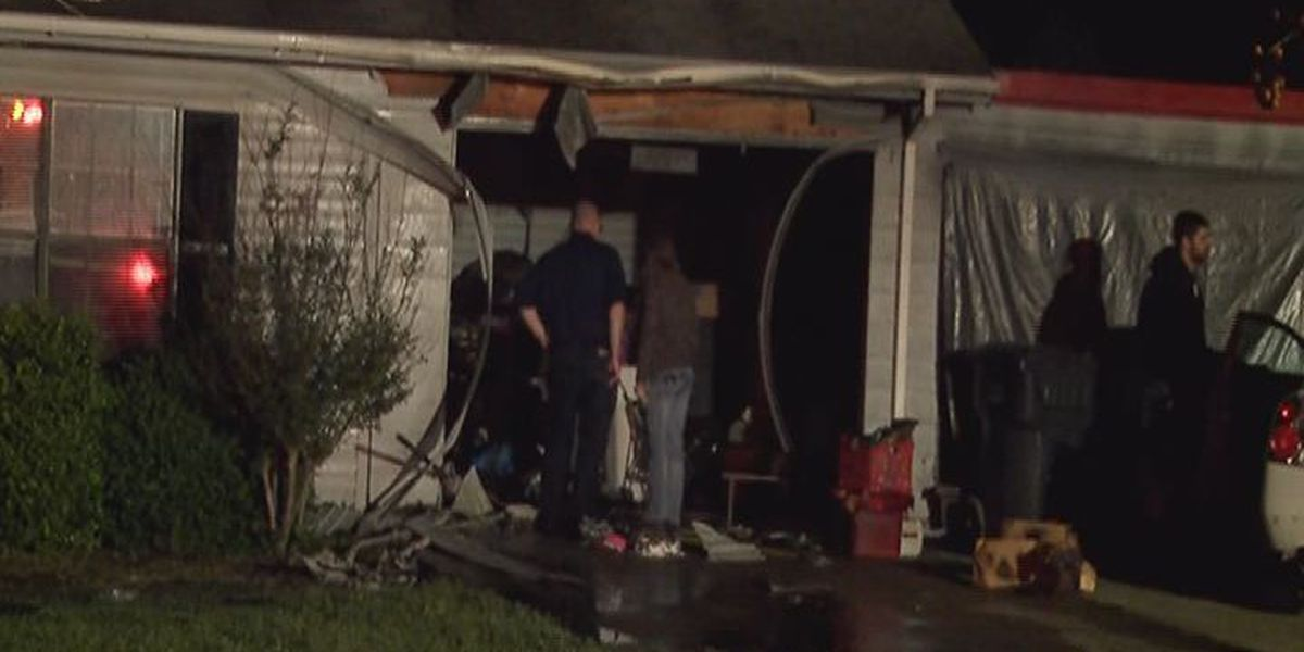 House fire destroys part of garage and attic
