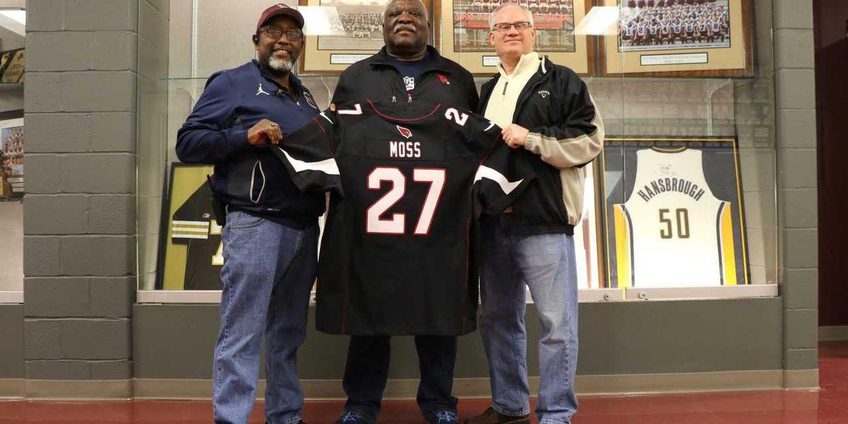 Former NFL player donates sports memorabilia to high school