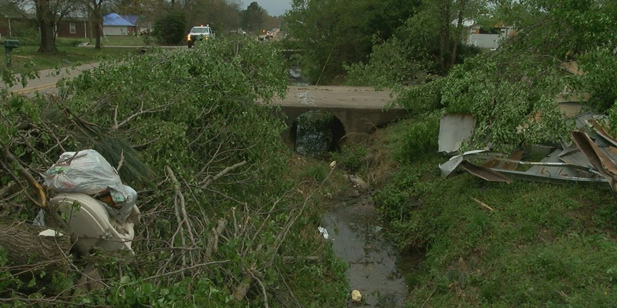Street crews clean debris from ditches due to rain