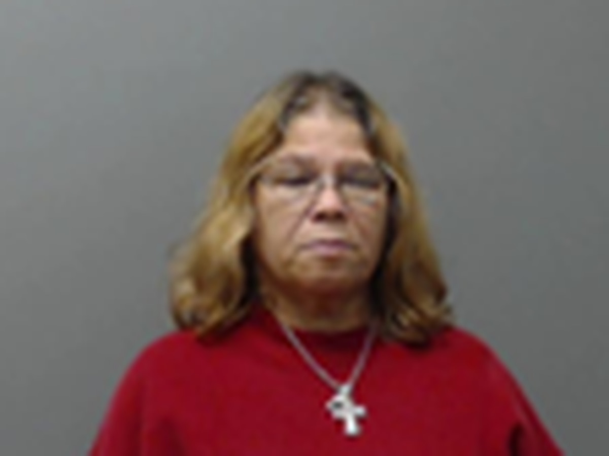 Vehicle crash leads to woman's arrest