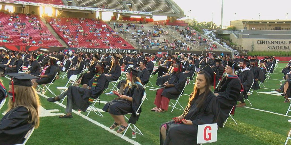 Summer graduates walk across the stage at Arkansas State University